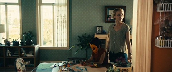 Screencap of Drive, the Rubik's cube is lying on a table.