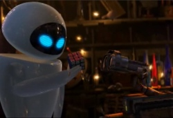 A white robot called EVE shows the solved Rubik's cube to WALL·E. WALL·E looks again very interested at the cube.